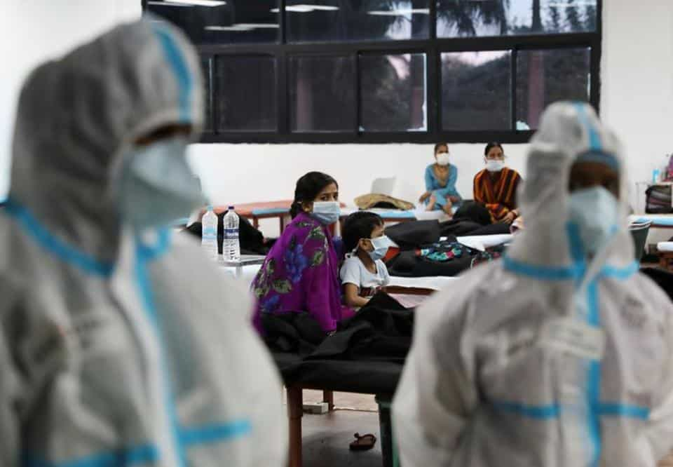 FILE PHOTO: A woman sits with her child inside a quarantine centre for the coronavirus disease (COVID-19) patients amidst the spread of the disease at an indoor sports complex in New Delhi, India, September 22, 2020. (Representational image)