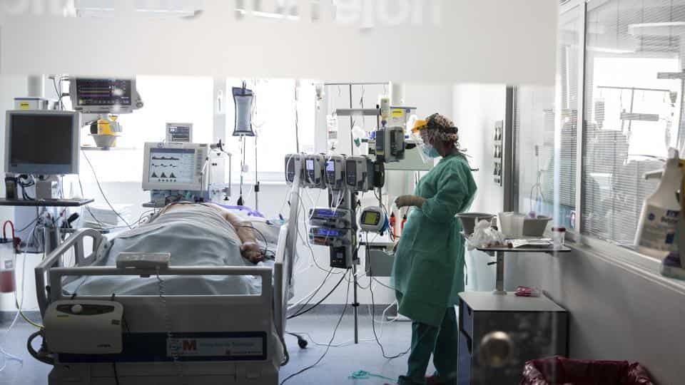 A healthcare worker looks at a patient with COVID-19 at an intensive care unit (ICU) . (Representational)