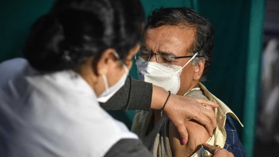 Health workers conduct a dry run of Covid-19 vaccination programme, at Hindu Rao Hospital in New Delhi.
